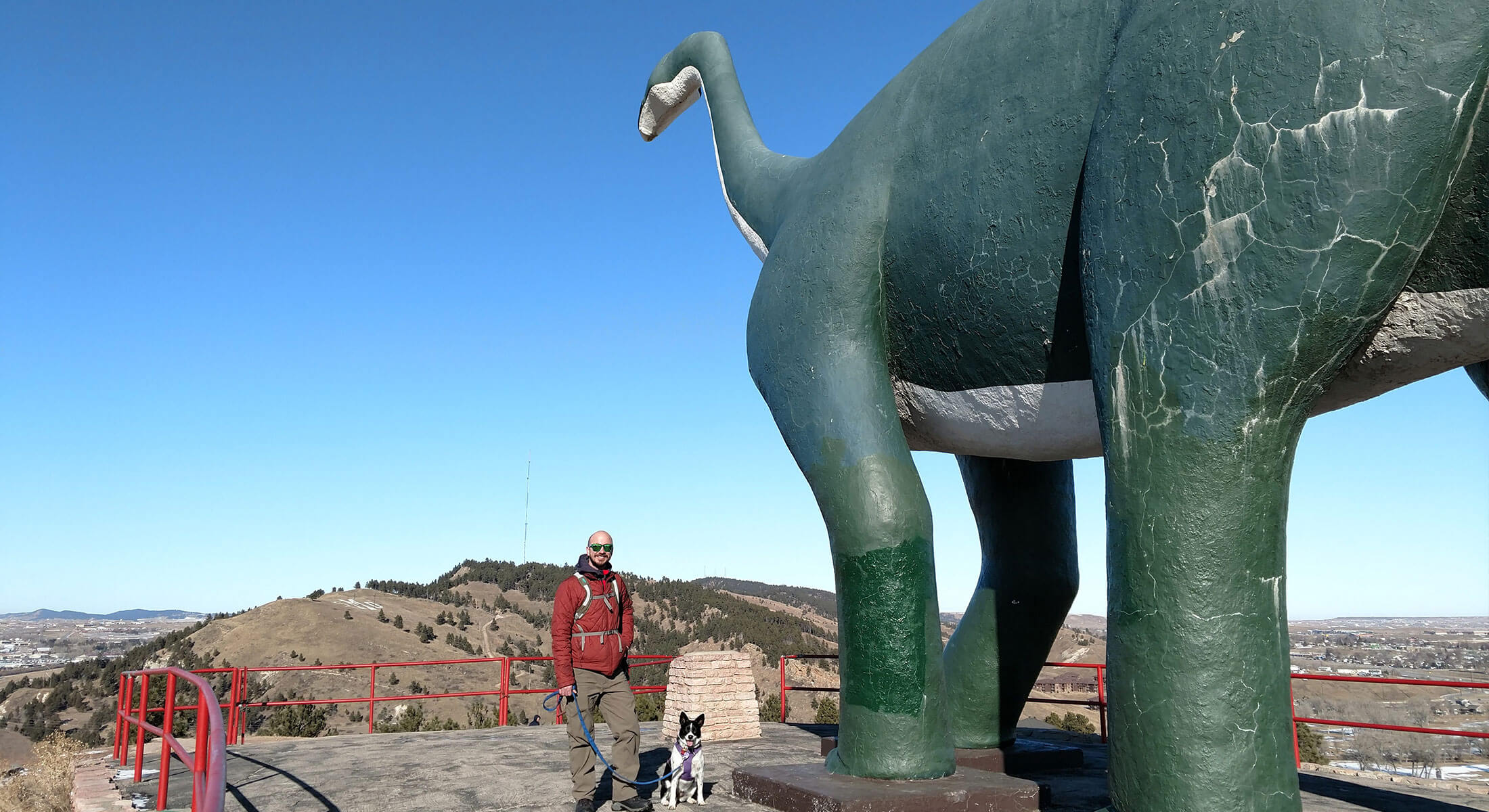 Standing next to the Dinosaur at Dinosaur Park