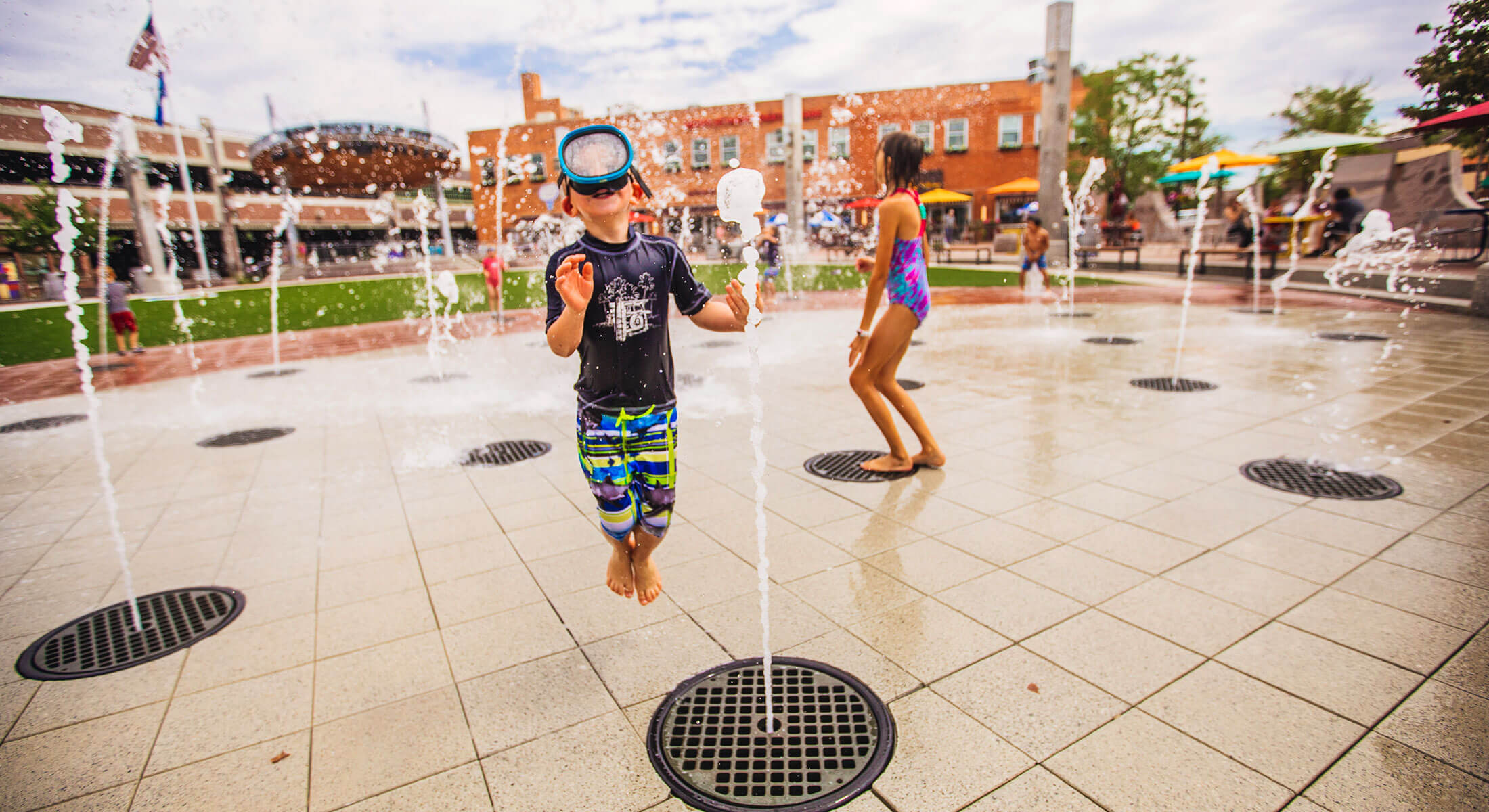 Kids playing in the Main Street Square Fountains