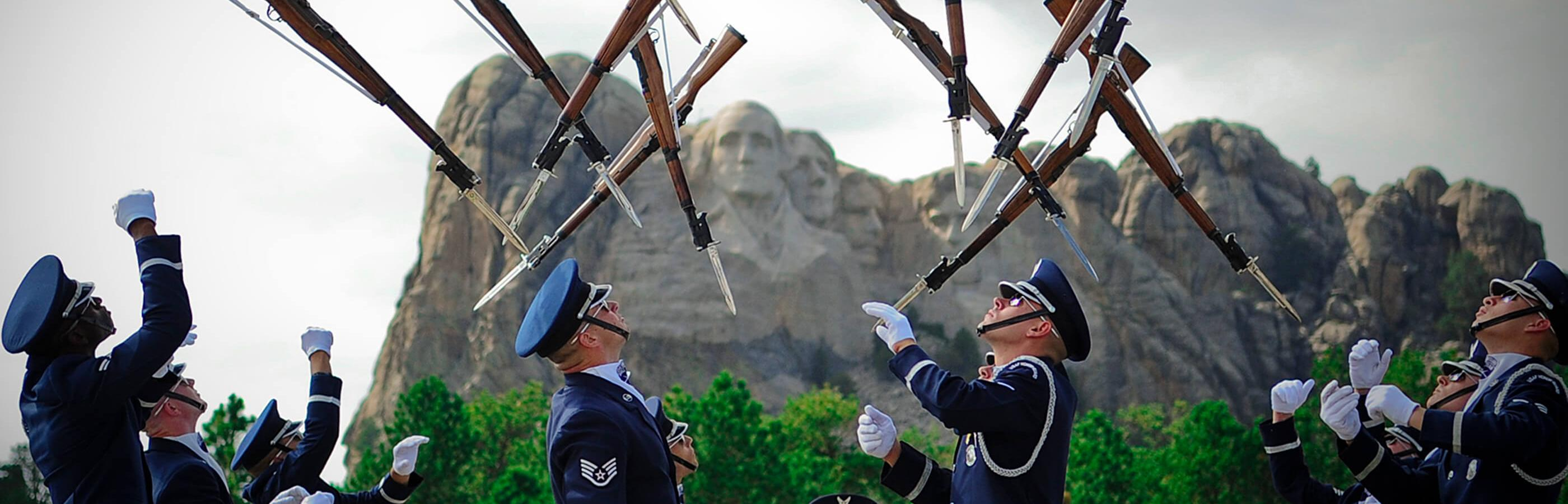 Drill guard performing in front of Mount Rushmore