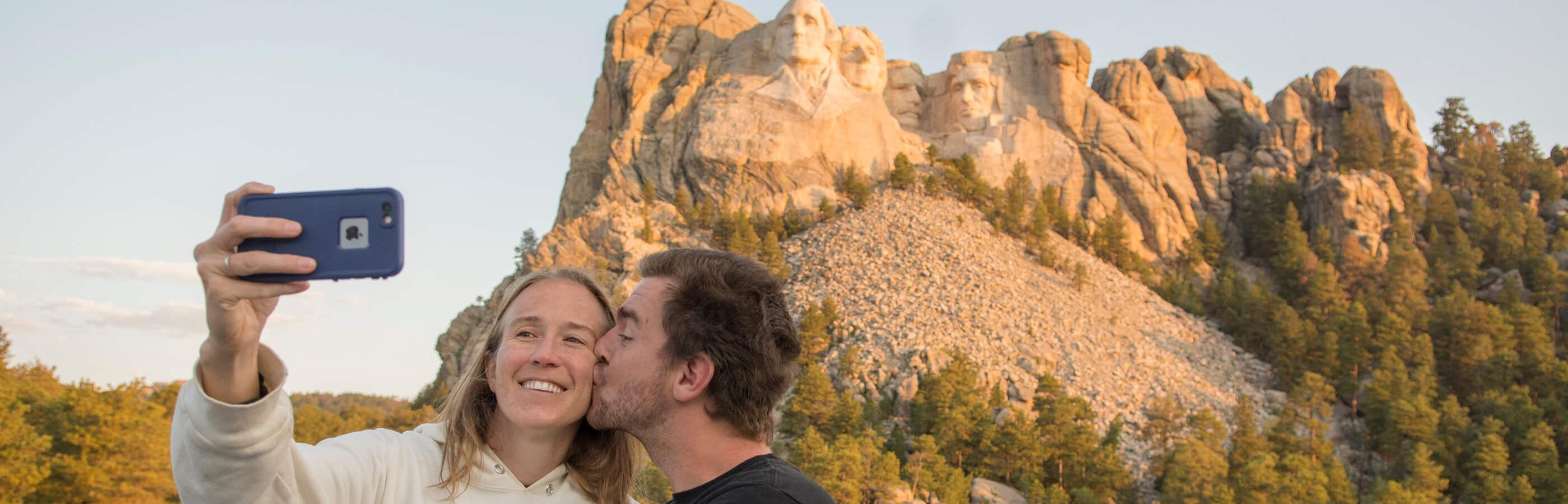 Couple taking a selfie at Mount Rushmore