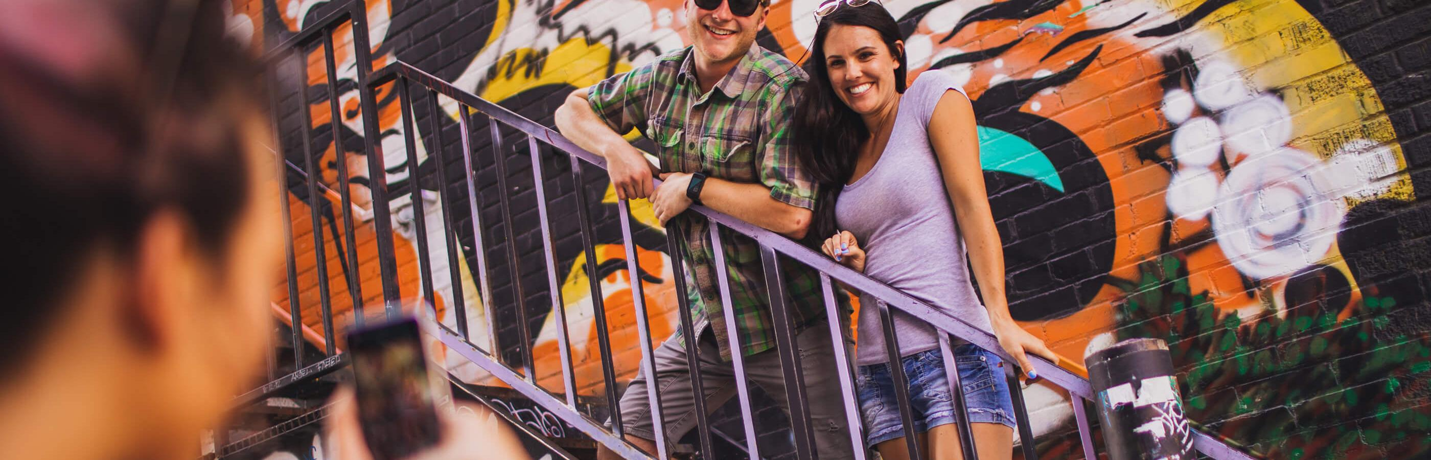 Two people posing in Art Alley Rapid City SOuth Dakota
