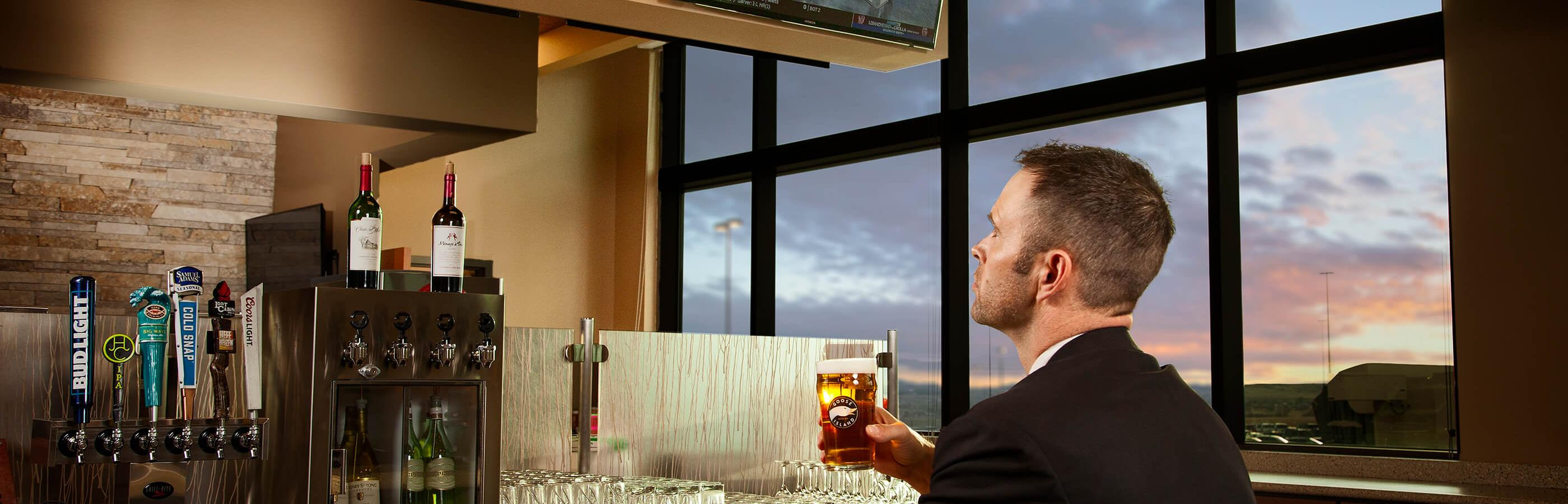 Man drinking beer at Air Host bar in the Rapid City SD Airport