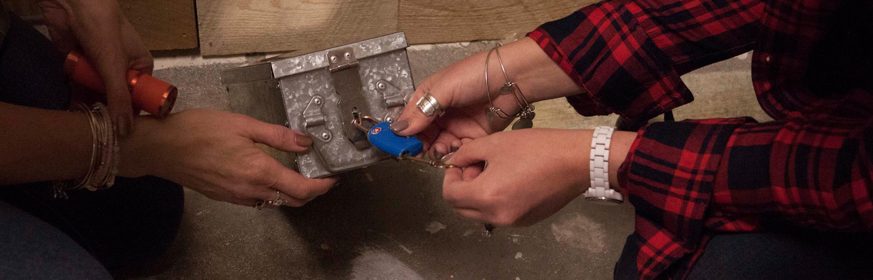 Unlocking a lock at Black Hills Escape Rooms