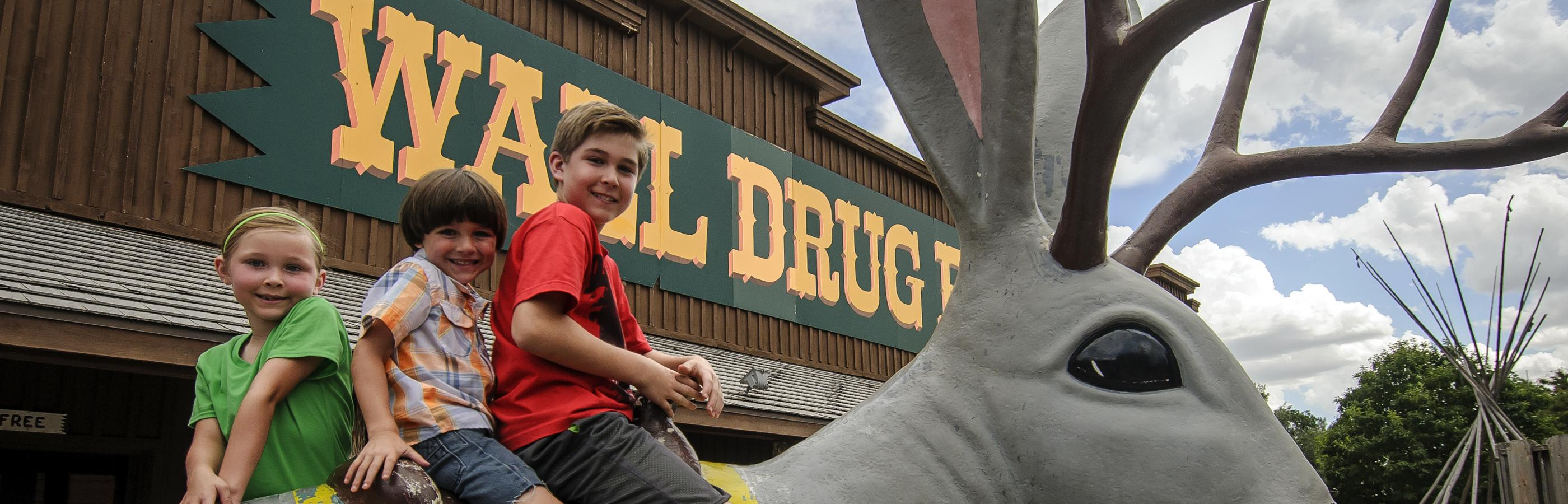 Kids Sitting on the Jack Rabbit at Wall Drug