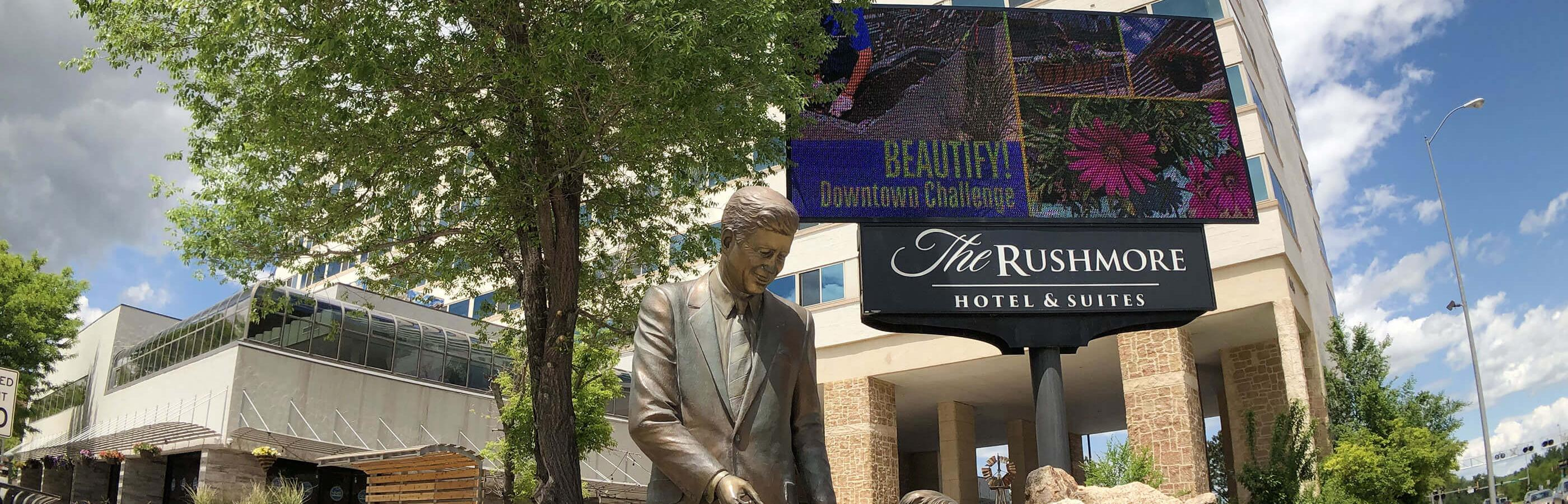 John F Kennedy Statue in front of the Rushmore Hotel and Suites