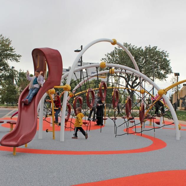 Kids Playing At Legacy Commons Playground