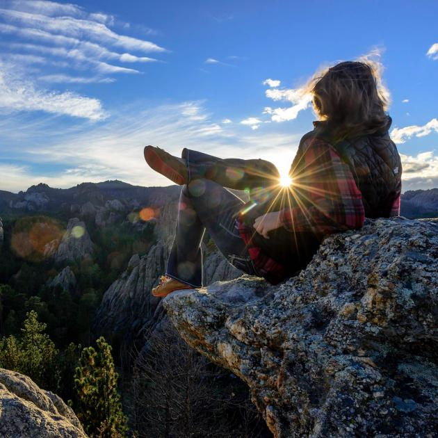 Person Hiking in the Black Hills National Forest at Sunset