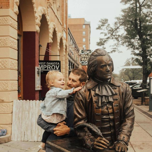 Father and Daughter Touring the City of Presidents Rapid City