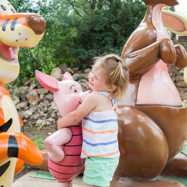 Child Hugging Piglet at Storybook Island In Rapid City, SD