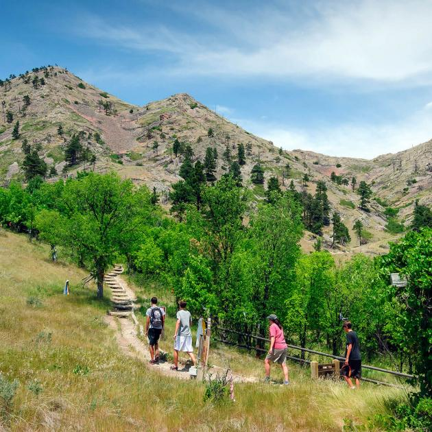 Hikers on the trail to the summit of Bear Butte