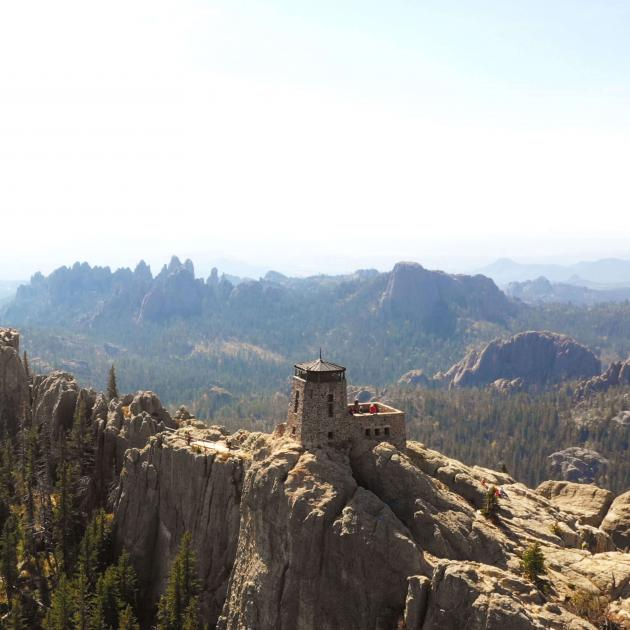 Distant view of the fire tower on the summit of Black Elk Peak